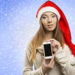 Christmas female showing iphone — Stockfoto #34571589