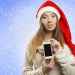 Christmas female showing iphone — Stock fotografie #34571589