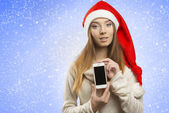 Christmas female showing iphone — Stock Photo
