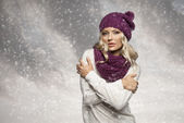 Winter girl in white with purple hat and scarf — Stock Photo