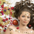 Close-up christmas portrait of brunette girl — Stock Photo #34958921