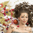 Pretty woman with christmas decorations — Stock Photo
