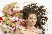 Christmas portrait of woman with xmas decorations — Stock Photo