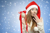 Funny xmas woman with bauble — Stock Photo