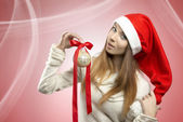 Pretty christmas girl with bauble — Stock Photo