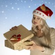 Stock Photo: Pretty christmas girl opening gift box