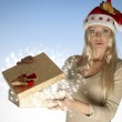 Surprised woman with christmas box — 图库照片 #35199607