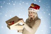 Happy girl open christmas present — Stock Photo