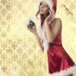 Attractive xmas woman with bauble — Stok fotoğraf