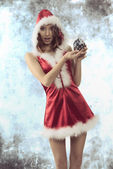 Sexy christmas woman with bauble — Stock Photo