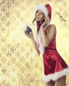 Attractive xmas woman with bauble — Stock Photo