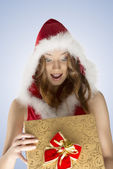 Very happy xmas woman opening gift box — Stock Photo