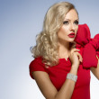 Cute blond young girl in red with big bow — Stock Photo #35828117
