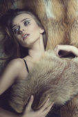 Sensual glamour woman on fur background — Stock Photo