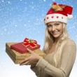 Christmas girl with gift boxes — Stock Photo