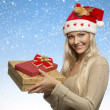 Christmas girl with gift boxes  — ストック写真