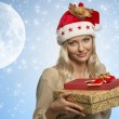 Woman with xmas hat and presents — Stockfoto