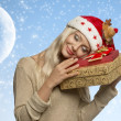 Calm woman with christmas gifts  — Stock Photo