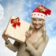 Smiling christmas girl with gift box — Stock Photo