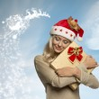 Adorable christmas female with present — Stock Photo