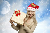 Smiling christmas girl with gift box — Stock Photo