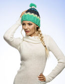 Blond young woman in winter dress — Stock Photo