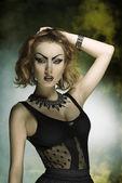 Fashion woman with bizarre style — Stock Photo