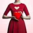Lovely girl with heart shaped box — Stock Photo #38110561