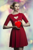Lovely girl with valentine gift — Stock Photo