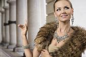 Smiling fashion aristocratic girl — Stock Photo
