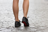 Close up on gym shoes on crack street — Stock Photo