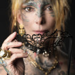 Lady in dark , with tattoo onface with mask — Stock Photo