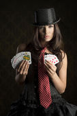 Burlesque girl with poker cards — Stock Photo