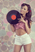 Sexy pin-up with vinyl disc — Stock Photo