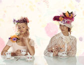 Two blonds girl with flowers hat — Stock Photo