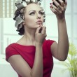 Makeup girl with hair rollers — Stock Photo #44608629
