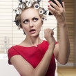 Funny woman with hair rollers — Stock Photo