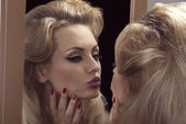 Vain girl in front of the mirror   — Stock Photo