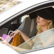 Pretty girl with hat driving — Stock Photo #45368981