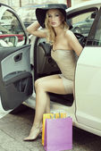 Blond sexy lady get out from car — Stock Photo