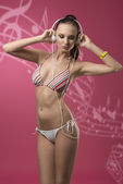 Bikini girl listening music  — Stock Photo