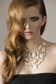 Charming girl with necklace  — Stock Photo