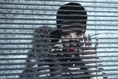 Jalousie woman near window  — Foto de Stock