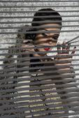 Gossip girl near shutters  — Stock Photo