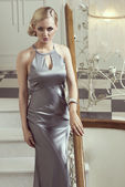 Elegant sensual woman on interior stair — Stock Photo