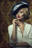 Young woman with vintage style in jewelry — Stock Photo