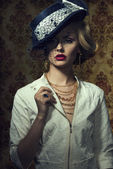 Young woman with style in jewelry — Stock Photo