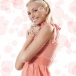 Blond beautiful girl standing and smiling against white backgrou — Stock Photo #6673812