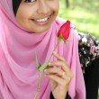 Portrait of beautiful young muslim girl holding a red rose flower — Stock Photo