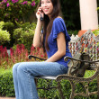 Beautiful asian woman using handphone — Stock Photo
